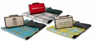 Picnic blanket from Kanata Blanket Co. lets you add your company logo. With two cover colors to choose from and three plaid interiors, you can have any of six beautiful combinations. The blanket is easy to carry and store and folds into a convenient cover with carry handle and Velcro closures.  Item EPICMIX.